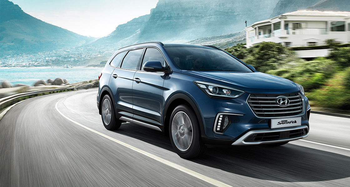 grand-santa-fe-gallery-side-front-navy-driving-fast-mountain-road-original